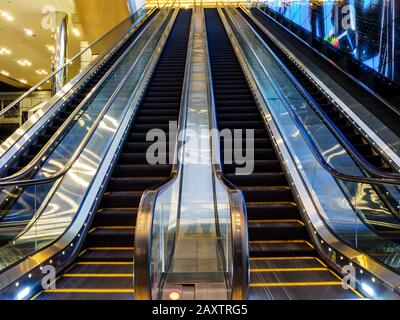 SINGAPORE – 6 MAY 2019 – Blurred motion shot of the empty escalators at Suntec City convention and exhibition centre in downtown Singapore - Stock Photo