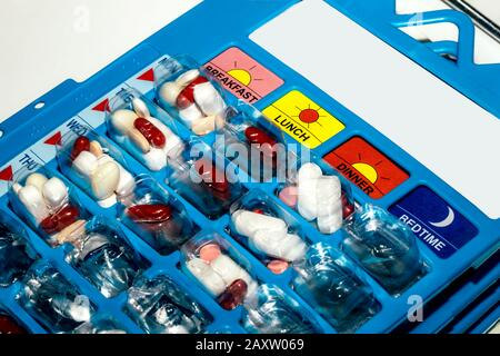Pills in blisters for every day of the week for the morning, day, night time. Medications for patients in a hospital. - Stock Photo