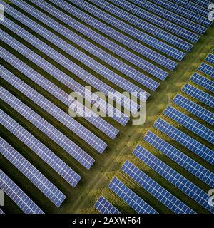 Solar energy farm. High angle, elevated view of solar panels on an energy farm in rural England; full frame background texture.