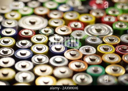 Recycling. Dozens of types, sizes, colors of used batteries and accumulators. Macro. - Stock Photo