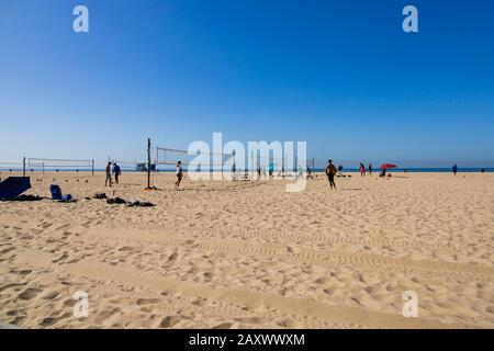 Playing volleyball on the beach. Santa Monica, California, United States of America. USA. October 2019 - Stock Photo