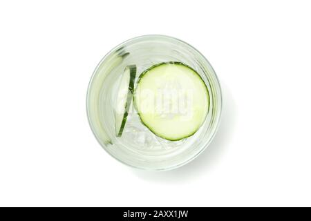 Glass with infused cucumber water isolated on white background - Stock Photo