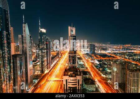 Night view of the spectacular landscape of Dubai with high-rises and skyscrapers at the Sheikh Zayed highway. Global travel destinations and real esta - Stock Photo