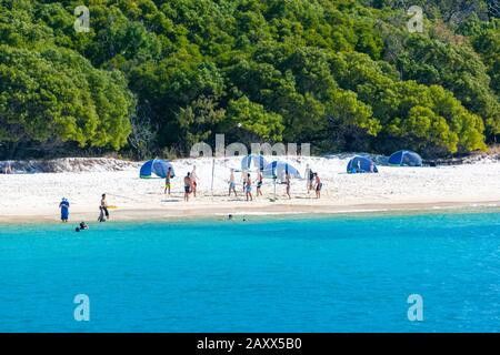 Playing volleyball in the Whitehaven Beach on Whitsunday Island, Queensland, Australia - Stock Photo