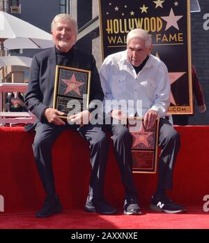 Los Angeles, United States. 13th Feb, 2020. Puppeteers Sid (L) and Marty Krofft hold replica plaques during an unveiling ceremony honoring them with the 2,687th star on the Hollywood Walk of Fame in Los Angeles on Thursday, February 13, 2020. Photo by Jim Ruymen/UPI Credit: UPI/Alamy Live News - Stock Photo