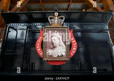 Photograph of Queen Victoria on the Restored CPR Engine 374 at the Roundhouse in Yaletown, Vancouver, British Columbia, Canada. - Stock Photo