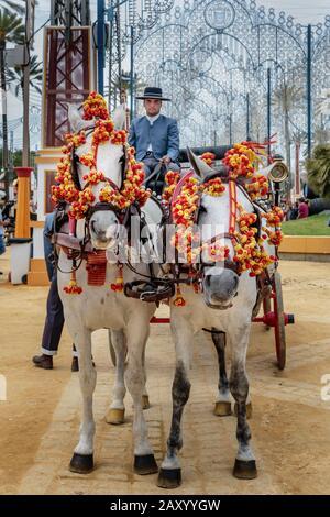 Traditional decorated horse-drawn carriage, Jerez Horse Fair (Feria de Caballo) , Jerez de la Frontera, Cádiz Province, Andalusia, Spain - Stock Photo