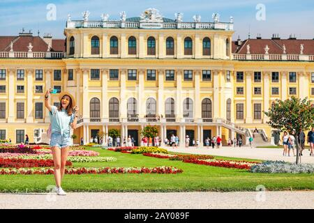 20 July 2019, Vienna, Austria: Happy young asian woman travel in Schoenbrunn royal palace garden. Travel and tourism in Vienna and Austria - Stock Photo