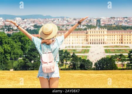 20 July 2019, Vienna, Austria: Happy young woman travelling in Schoenbrunn royal palace garden - Stock Photo
