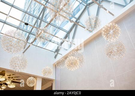 Modern transparent glass ceiling roof, modern chandeliers - roof top room design concept in daylight and blue sky. - Stock Photo