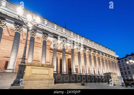 23 July 2019, Lyon, France: Illuminated building of courthouse Cour de Appel in Lyon, France. Photo taken at blue hour in twilight - Stock Photo