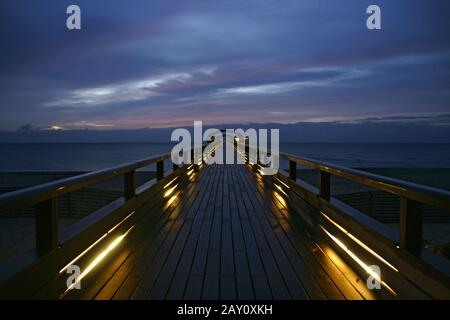 Sunset at the pier in Kellenhusen, Baltic Sea, Ger - Stock Photo