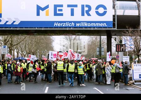 Real employees demonstrate against the sale of the stores before the Metro AG Annual General Meeting - Stock Photo