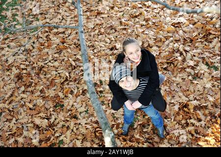 Romantic Teenage Couple By Tree In Autumn Park - Stock Photo