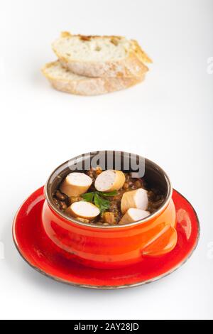 Lentil soup with wiener - Stock Photo