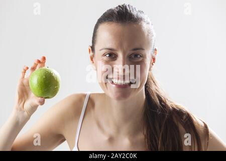 Young woman with an apple - Stock Photo