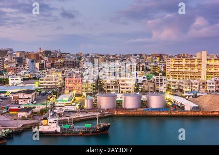 Naha, Okinawa, Japan industrial cityscape along Tomari Port at twilight.
