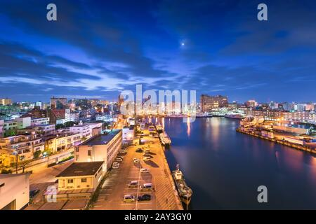 Naha, Okinawa, Japan downtown skyline at dawn from Tomari Port.