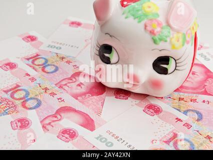 piggy bank on china banknote