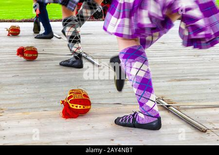 Children, Feet, Socks, Legs. Traditional Scottish Highland reel dancers at the annual Braemar Highland games and gathering Scotland, UK. - Stock Photo