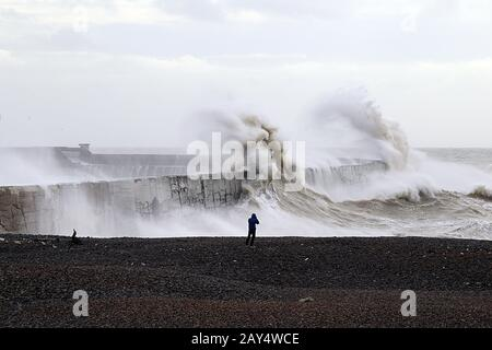 Giant waves crash against the breakwater after storm Ciara, at Newhaven East Sussex UK - Stock Photo