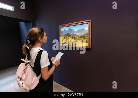 27 July 2019, Orsay museum, Paris, France: Asian woman tourist visits famous museum with impressionist paintings collection - Stock Photo
