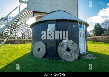 Lowfield Heath Windmill, a grade II listed post mill at Charlwood, Surrey, England, with millstones. Visitor attraction, UK