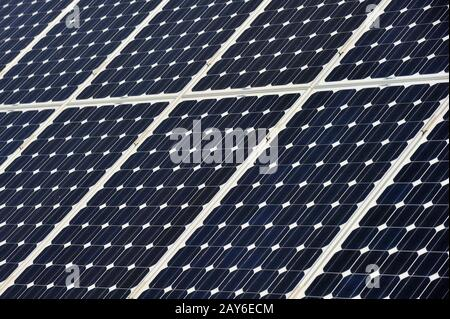 Close-up of photovoltaic solar panels on roof - Stock Photo