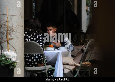 Milan, Italy. 14th Feb, 2020. Nick Jonas and wife Priyanka Chopra lunch in the center Nick Jonas, one of the 3 brothers of the famous musical group 'JONAS BROTHER' in concert this evening in Milan, surprised at lunch in a well-known restaurant in the center together with his wife Priyanka Chopra, actress model and Indian singer, winner of the beauty contest Miss World 2000, first Bollywood actress to have won 5 filmfare Awards in 5 different categories. In 2015 protagonist of the US TV series 'Quantico', and he is Goodwill Ambassador of UNICEF. Credit: Independent Photo Agency Srl/Alamy Live N - Stock Photo
