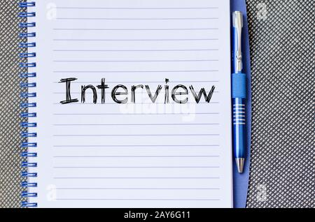 Interview text concept on notebook - Stock Photo