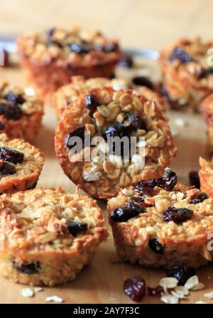 muffins with oatmeal and dried fruit. sweet breakfast. Tasty and homemade sweets. Homemade pastries. - Stock Photo