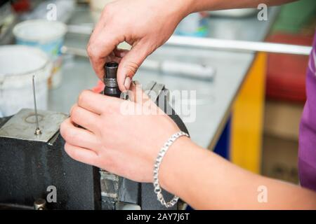 Male hands dismantle a mechanical diesel nozzle to replace the sprayer - Stock Photo