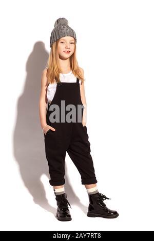 little girl in dark overall on the white background