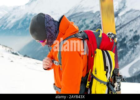 A close-up portrait of a freeride skier on the climbing track for freeride-descent. - Stock Photo