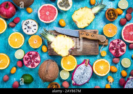 Exotic fruits and citrus whole and sliced - Stock Photo