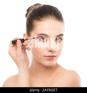 Eye make up apply. Mascara applying closeup, long lashes. makeup brush. Isolated. - Stock Photo