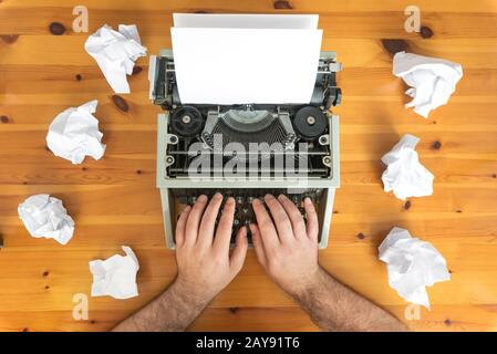 Writer's block. Typewriter and crumpled paper on work desk. Creative process concept - Stock Photo