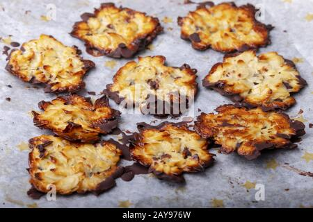 homemade Florentines on baking paper - Stock Photo