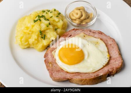 bavarian snack Leberkaese with potato salad - Stock Photo