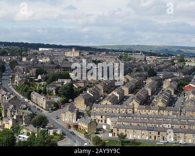 panoramic view of Halifax in west yorkshire with rows of terraced streets buildings and roads - Stock Photo