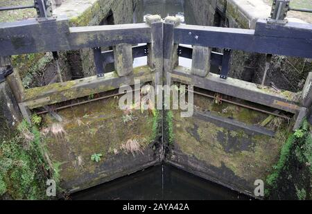 old wooden lock gates on the rochdale canal - Stock Photo