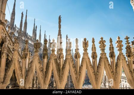View to spires and statues on roof of Duomo in Milan