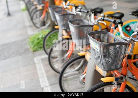 row of bicycles called Ubike, a bike sharing system service