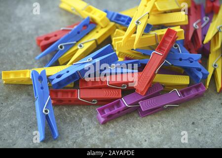 Colorful Plastic Clothespins Scattered - Stock Photo