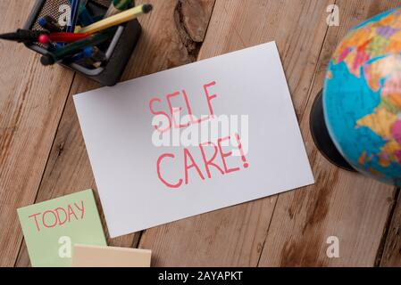 Writing note showing Self Care. Business photo showcasing practice of taking action to preserve or improve ones own health Writi - Stock Photo