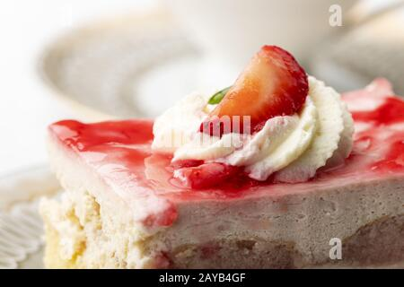 Strawberry cake and a cup of coffee - Stock Photo