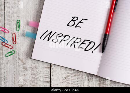 Conceptual hand writing showing Be Inspired. Business photo text fill someone with urge or ability to do or feel something Noteb - Stock Photo