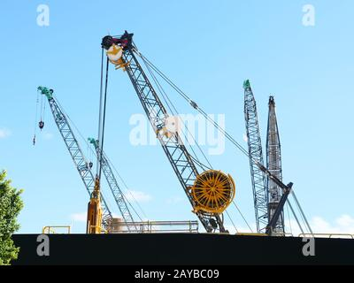 Unusual construction crane seen in the harbour area of Perth Australia on a construction site. - Stock Photo