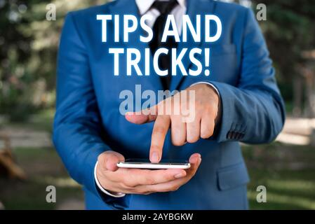 Writing note showing Tips And Tricks. Business photo showcasing means piece advice maybe suggestion how improve Businessman with - Stock Photo
