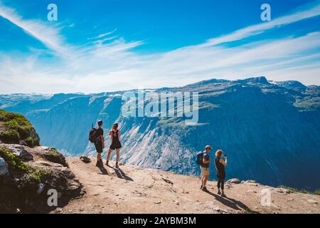 July 26, 2019. Norway tourist route on the trolltunga. People tourists go hiking in the mountains of Norway in fine sunny weathe Stock Photo